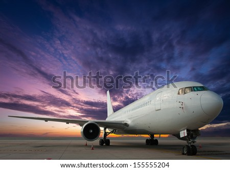Commercial airplane with sunset - stock photo