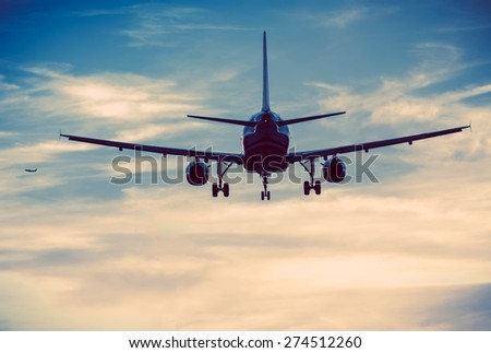 Commercial Airplanes on the Sky. Urban Blue Color Grading. Air Transportation Concept. - stock photo