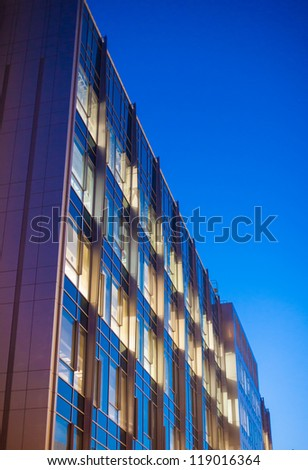 Commercial building, architectural detail, seen at dusk - stock photo