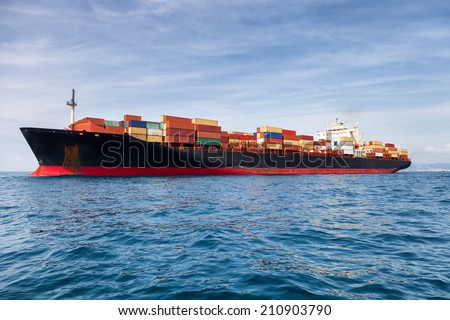 commercial cargo ship carrying containers - stock photo