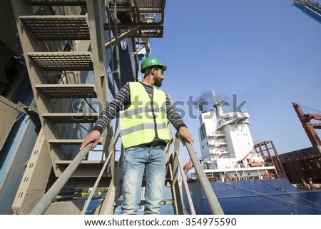 Commercial docks worker and inspector at work theme concept/Egyptian Arabic Inspector at Arabian port in Middle East Africa