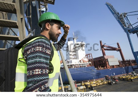 Commercial docks worker and inspector at work theme concept/Egyptian Arabic Inspector at Arabian port in Middle East Africa  - stock photo