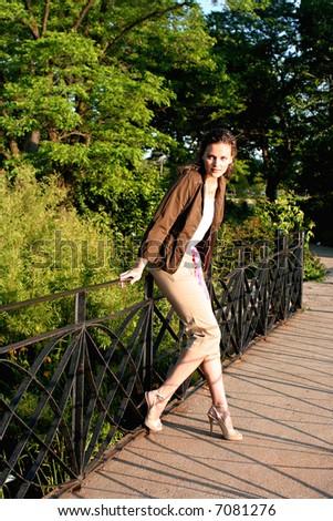 commercial female model on the bridge - stock photo