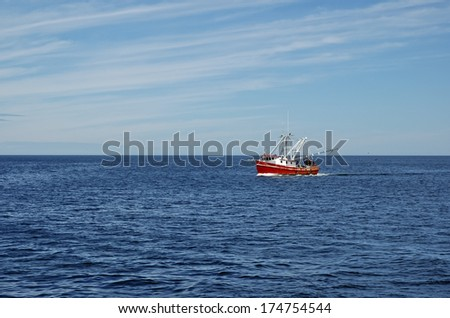 Commercial Fishing Boat in the Ocean - stock photo