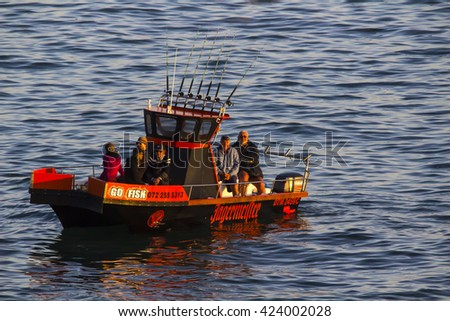 Commercial Fishing Boat taking client out to the ocean for some fishing on the 4th of May 2016 Mosselbay South Africa