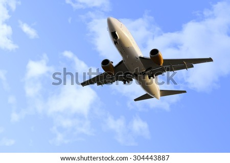 commercial flight of airplane close up view flying on blue sky with clouds during  take off procedure in transportation, business travel and holiday journey concept