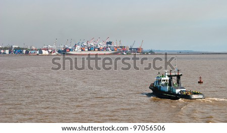 Commercial harbor with boats and containers