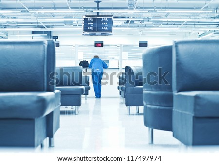 commercial interior with visitor - stock photo