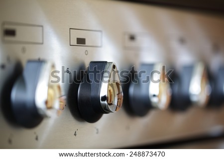 Commercial kitchen stove temperature controls - stock photo