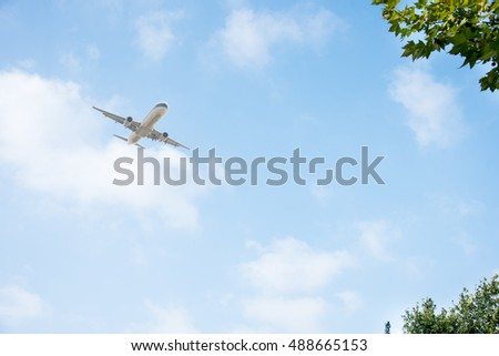 commercial plane flying against blue sky,china.
