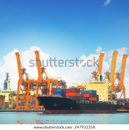 commercial ship and cargo container on port use for import export and freight logistic water transport industry - stock photo