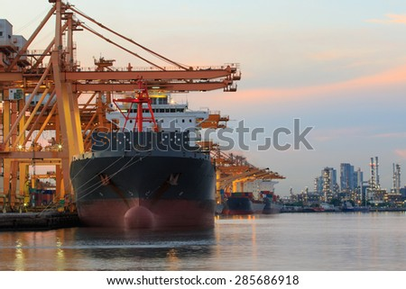 commercial ship loading container goods in ship yard use for transport and logistic cargo freight business - stock photo