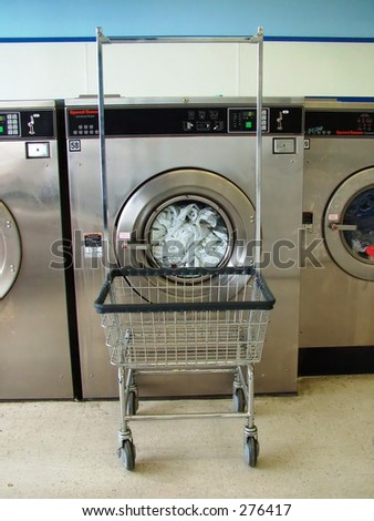 Commercial washing machine with cart - stock photo