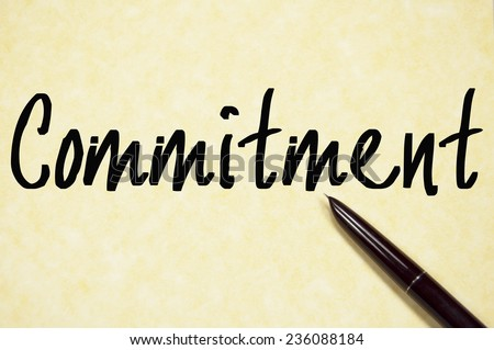 commitment word write on paper  - stock photo