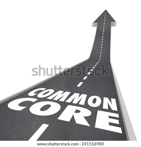 Common Core words on a road leading upward to success to illustrate new school standards in learning and testing and revised curriculum - stock photo