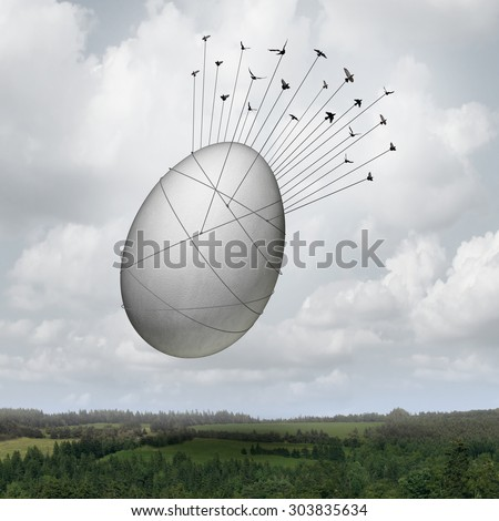 Common goal business concept as a collective team of birds pulling a giant egg as a financial symbol and a metaphor for working together for an investing group or company pension teamwork success. - stock photo