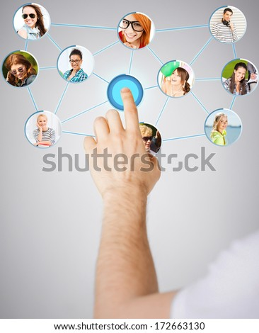 communication and networking concept - closeup of man hand pointing at social network