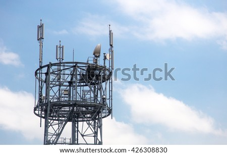 communication antenna tower with blue sky. - stock photo