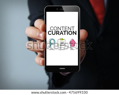 Communication concept: businessman hand holding a touch phone with content curation graphic on the screen