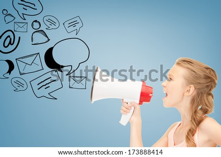 communication concept - girl with megaphone over blue background - stock photo