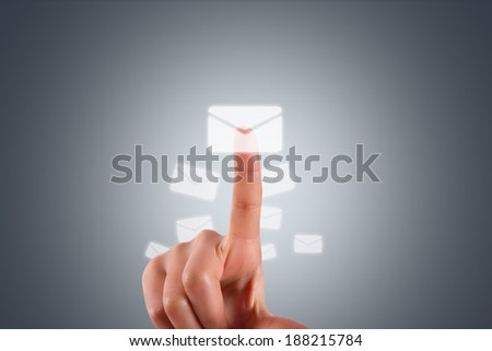 Communication concept, young female hand finger touching, pressing modern email button on digital screen interface on dark background. - stock photo