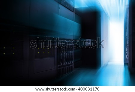 Communication switch near the mainframe in data center with blur and motion - stock photo