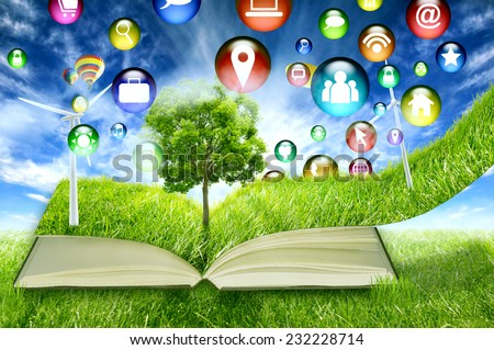 communication technology high tech social media application symbol icon flying in green micro world book green grass wind energy turbines. Sustainable source electricity concept. Eco friendly approach - stock photo
