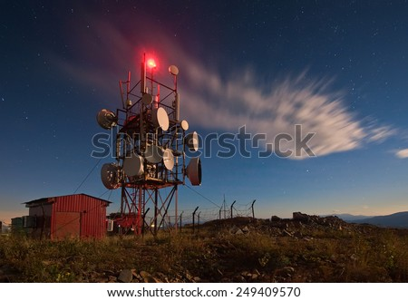 Communication tower at night. - stock photo