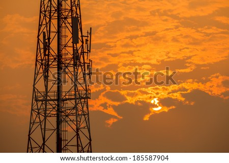 Communication tower during sunset - stock photo