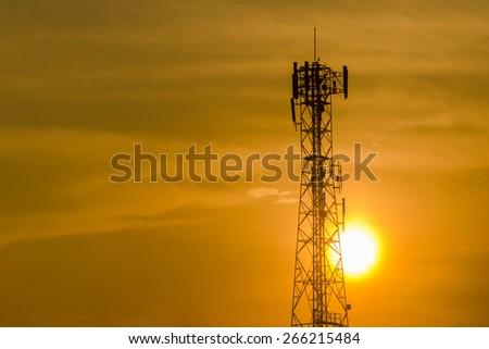 Communication tower on sunset background - stock photo