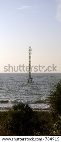 Communication Tower on the Gulf of Mexico. - stock photo