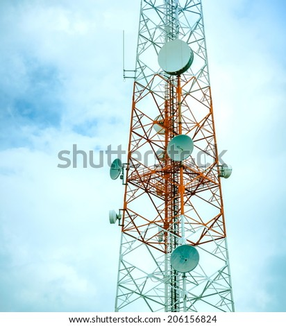 communications antenna is in the sky - stock photo