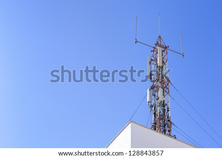 Communications Antenna Tower on a building roof