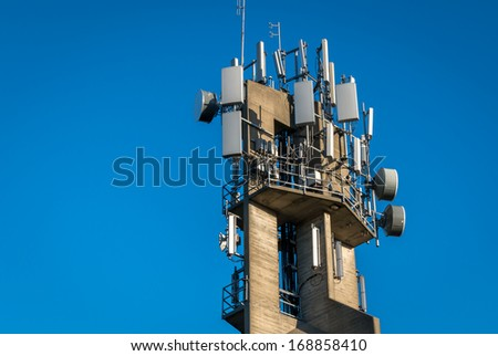 Communications equipment on a high concrete tower provides long range signals over the city.