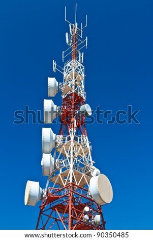 Communications tower with a beautiful blue sky - stock photo