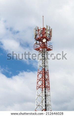 Communications tower with antennas against on sky - stock photo
