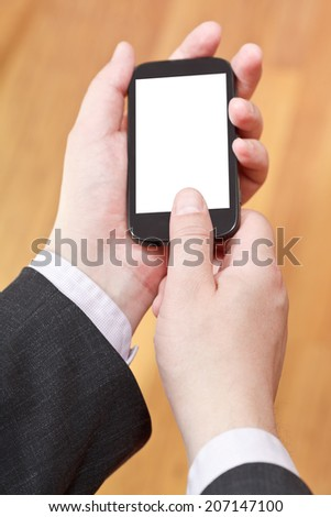 communicator with cut out screen in businessman hands close up - stock photo