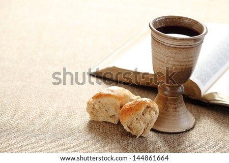 Communion still life - wine, bread and Bible - stock photo