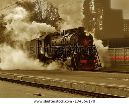 Communist locomotive with red star the early 20th century, stands on railroad tracks - stock photo