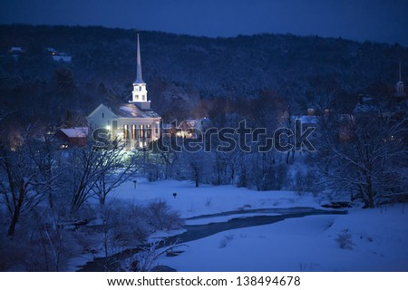Community church at dusk during the winter, Stowe, Vermont, USA - stock photo