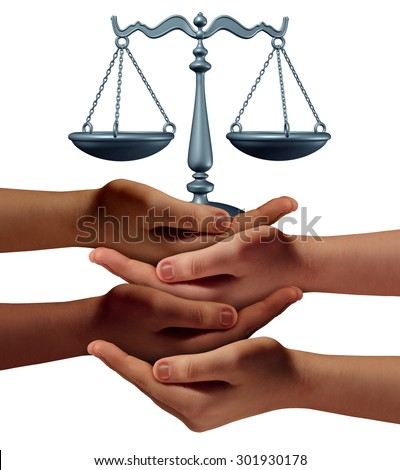 Community legal assistance concept with a group of hands representing diverse groups of people cooperating together to provide law and justice support and advice holding a justice scale. - stock photo