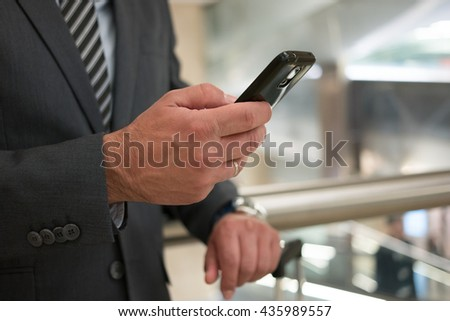 Commuter looking at his mobile phone
