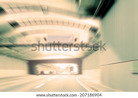 Commuter traffic - captured in an urban expressway (motorway) tunnel.  - stock photo