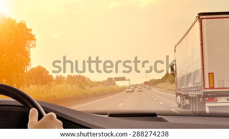 Commuter Traffic - Driving a car on an expressway/motorway at sunset  - stock photo