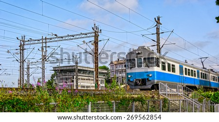Commuter train arrives at Central railway station in Helsinki, Finland - stock photo