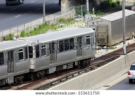 Commuter train in the city - stock photo