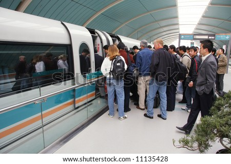 Commuters boarding Shanghai Maglev Train - 'bullet train' in Shanghai, China