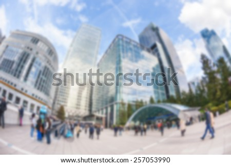 Commuters in Canary Wharf, financial district of London, blurred background - stock photo