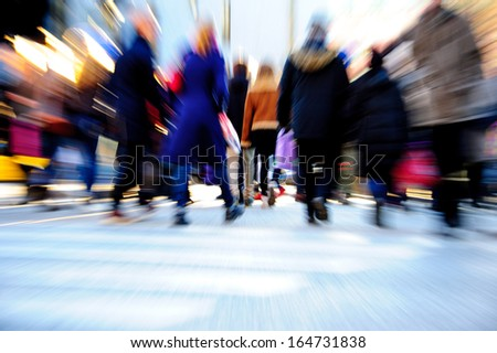 Commuters in motion blur - stock photo