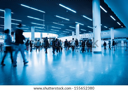 commuters in rush hour with shanghai subway transfer center hall - stock photo